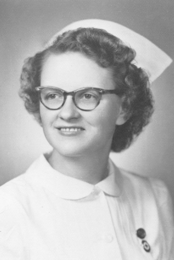 Black and white photo - Alice Johnson wears a nursing uniform with a pin.