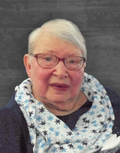 Jean wears a blue snowlake-patterned scarf.